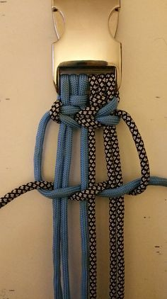 Possibly for older kids? a survival type bracelet with gray and black cords... probably too much dexterity is required.