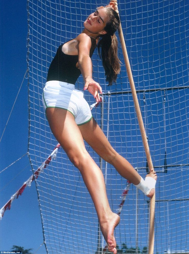 Look at me: Brooke Shields strikes a carefree pose as she practices acrobatic stunts at a California home
