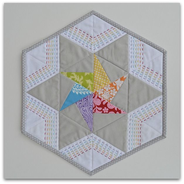 The Sewing Chick: I *heart* Minis - I love the rainbow stitched quilting on this hexagon star quilt