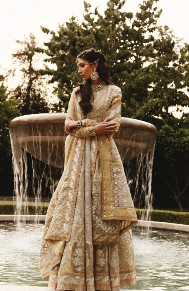 A stunning ivory and gold anarkali by designer Abu Jani Sandeep Khosla for Pernias Pop Up Shop. More on picking a timeless anarkali for your wedding, www.bridelan.com #Bridelan