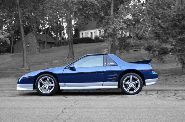 My Blue 85GT (Pontiac Fiero) with a souped up 3.4L...love this car!