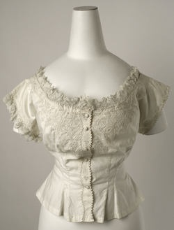 1850-1870 Costume for Women. A corset cover  was a camisole that was placed over the corset and chemise.