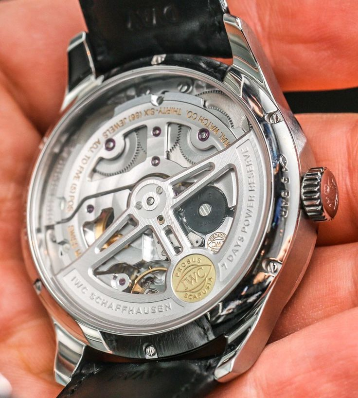 """IWC Portugieser Annual Calendar Watch Hands-On - by Ariel Adams - See all the hands-on pictures & read more on aBlogtoWatch.com """"For me, the most impressive element of the 2015 IWC Portugeiser Annual Calendar watch is the movement. Flip the large 44.2mm wide case on its rear, and through the expansive sapphire crystal caseback window, you'll see what is a fantastic example of modern mechanical watch movements - the in-house made IWC caliber 52850..."""""""