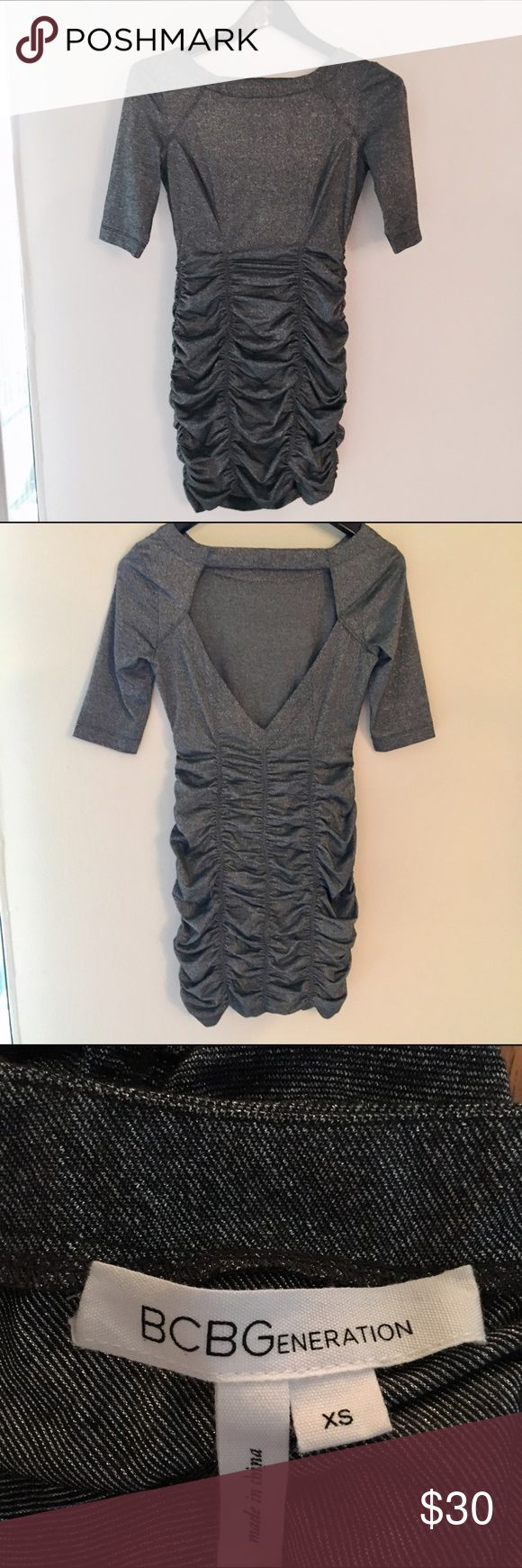 BCBGeneration Silver Open Back Ruche Bodycon Dress This sexy metallic bodycon dress in a dark grey/silver is perfect for New Year's Eve or other holiday parties. The dress is stretchy and the ruching makes it very figure flattering. Only worn twice. Good condition. BCBGeneration Dresses Long Sleeve