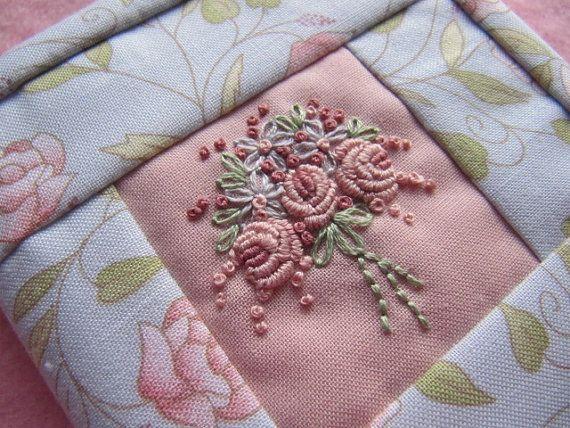 Needlebook embellished with bullion roses.