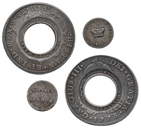 In 1812 Governor Lachlan Macquarie imported 40,000 Spanish dollars, called 'pieces of eight', and had William Hensell, a convicted forger, cut the centre out of each one. Overstamped, the result became known as the 'holey dollar & dump' - the first currency minted in Australia.