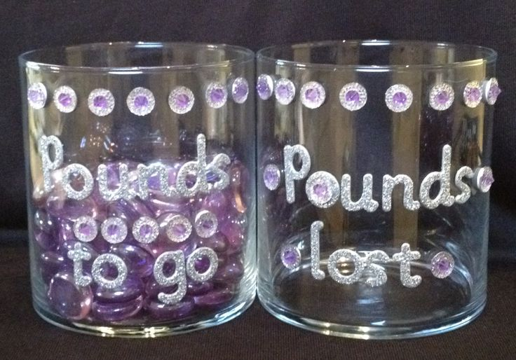 "These are my weight loss inspiration jars. There are 100 stones in in the ""pounds to go"" jar, and I intend to have them switched to the ""pounds lost"" jar by year's end. Wish me providence."