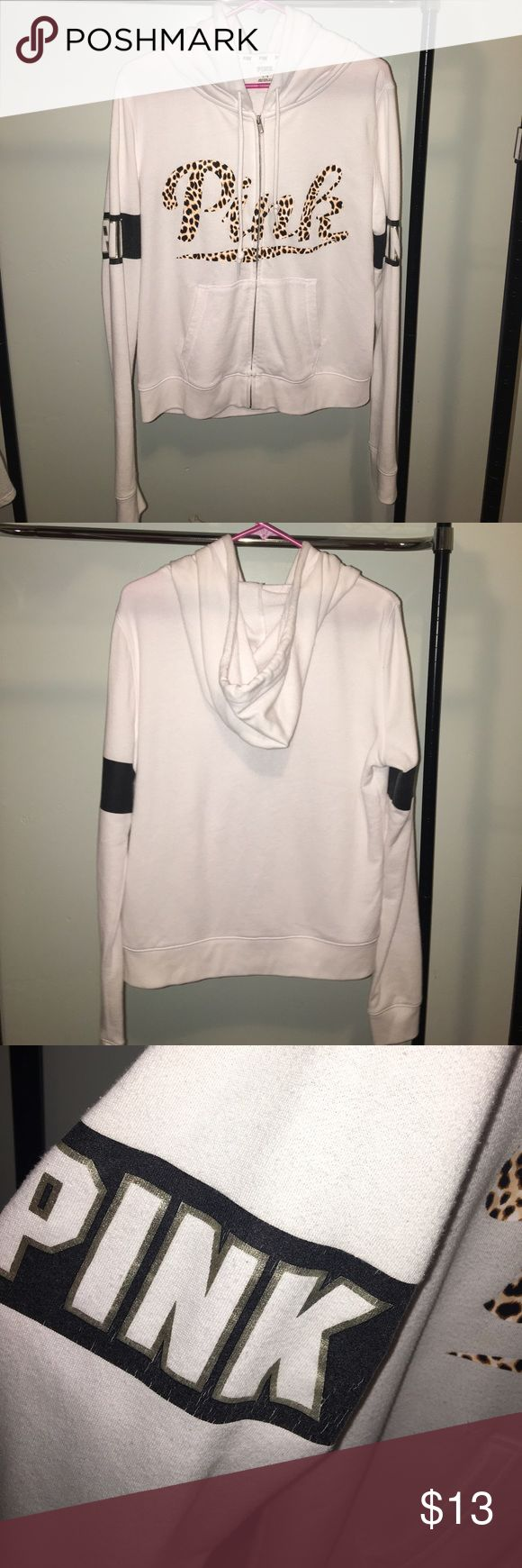 """Leopard """"PINK"""" white zip up hoodie This item did not previously sell and is still available in my closet. Loose, comfy, clean, no stains. Minor fading on black arm bands (see pic) Smoke free, pet free home. Last of my winter sweatshirts. PINK Victoria's Secret Sweaters"""
