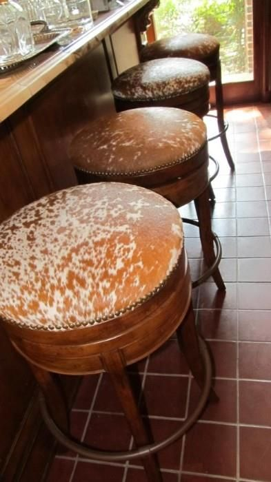 Found on EstateSales.NET: Cowhide bar stools.  Welcome to Texas!