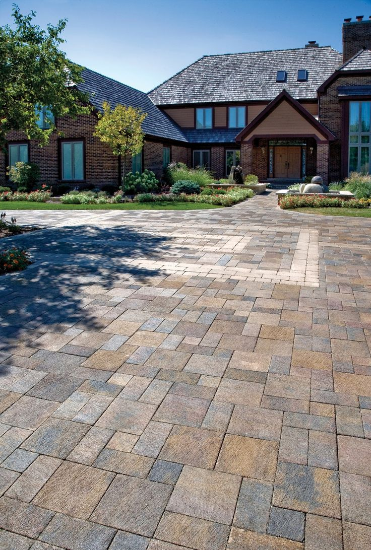 Driveway with Il Campo Unilock pavers and Brussels Block