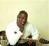 Chester Arthur Burnett (June 10, 1910 – January 10, 1976), AKA Howlin' Wolf. Blues singer, guitarist and harmonica player.