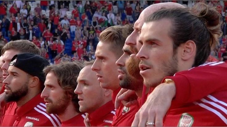 The Wales football team are greeted by thousands of fans as they parade through Cardiff city centre in an open top bus.