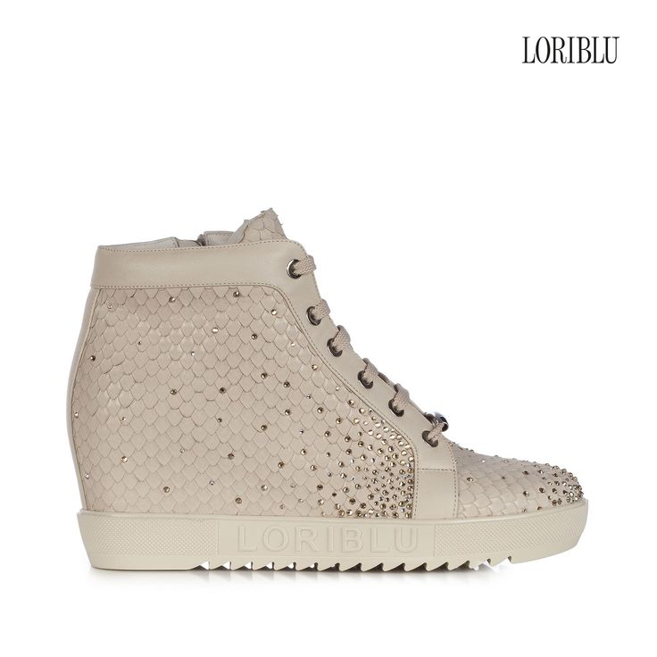 Sand python print suede wedge sneaker. The original pattern, joined to the hand-applied SWAROVSKI ELEMENTS, will add an incomparable dash of elegance to your casual outfit.