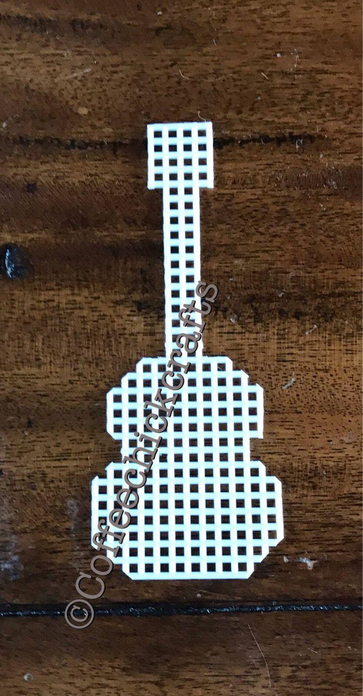Plastic Canvas guitar cutout shape  https://www.etsy.com/listing/521673832/plastic-canvas-guitar-shape-plastic