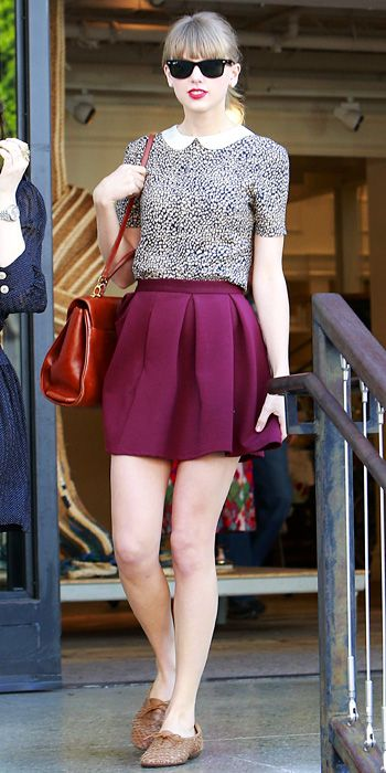 Black shades, black spotted sleeved top, plum coloured skirt, brown sandals and a red vintage bag...