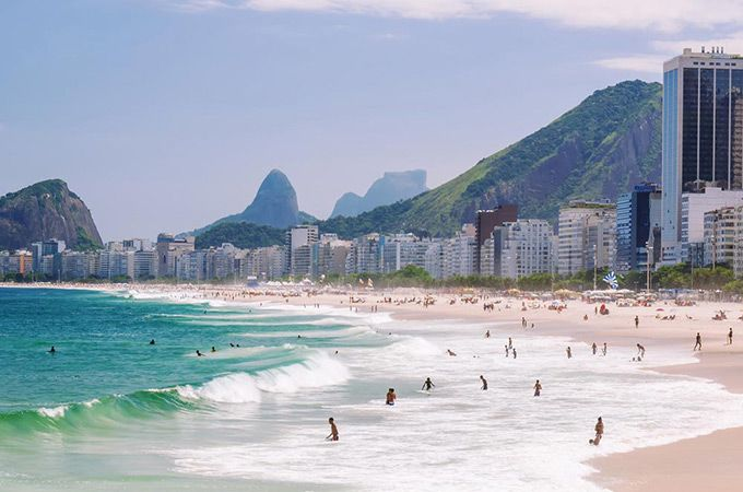Best Beaches - Copacabana Beach, Brazil: For sheer spectacle and non-stop entertainment, it's got to be Copacabana in Rio de Janeiro. The moment you step foot on this fabled beach local lads will sort you out with sun loungers and umbrellas, and a never-ending supply of liquid refreshments: beer, caipirinhas, soft drinks and freshly opened coconuts