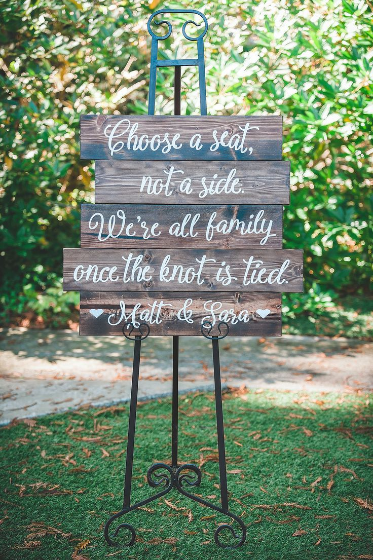 "A perfect sign to greet the wedding guests at Matt and Sara's Miranda Garden wedding in Miranda, California | ""Choose a seat, not a side. We're all amily once the knot is tied.""