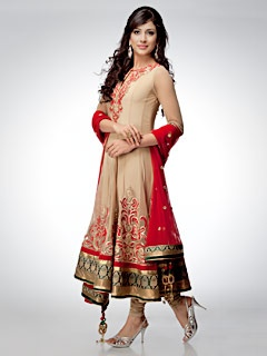 Paint the town red with this picturesque beige anarkali suit with red dupatta. The suit has motifs in red on the yoke and border.