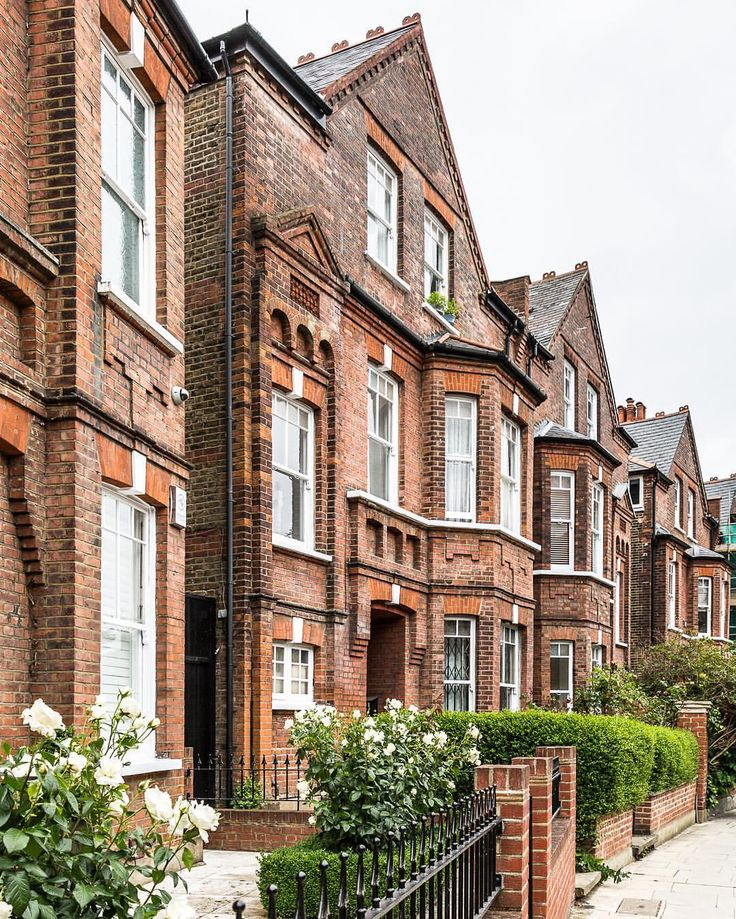 Row of exposed brick houses in Hampstead, London