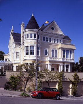 """of the Victorian-era homes. These homes were popular from the 1870s through the 1900s and were greatly influenced by British architect Richard Norman Shaw. The style is often characterized by ornamentation and excess — steep rooflines and porches with decorative gables, circular towers, decorative windows"""