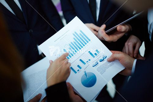 Image Of Business Document Held By Man And Being Pointed At By Woman At Meeting