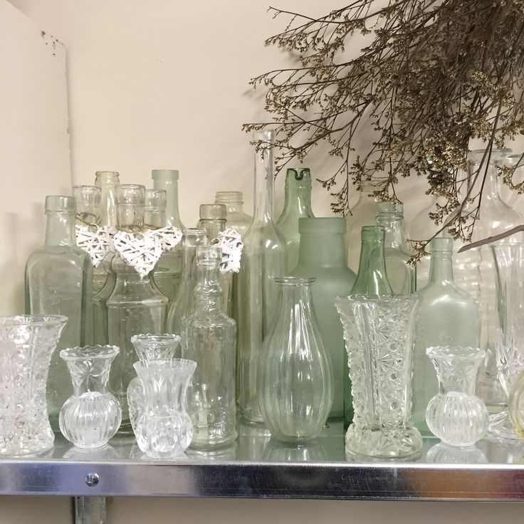 some of my large collection of cut glass vases and glass bottles