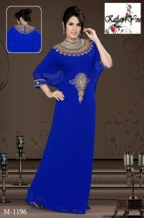 This Royal Blue dress features white hand beaded sequin combined with pearls and sapphire blue coloured gems along the neckline and covering the bust