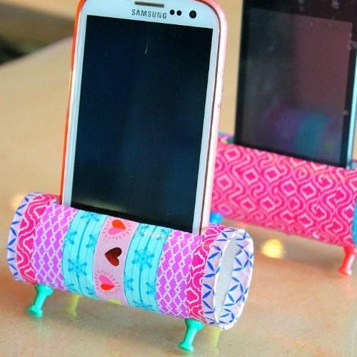 DIY phone stand with toilet paper rolls