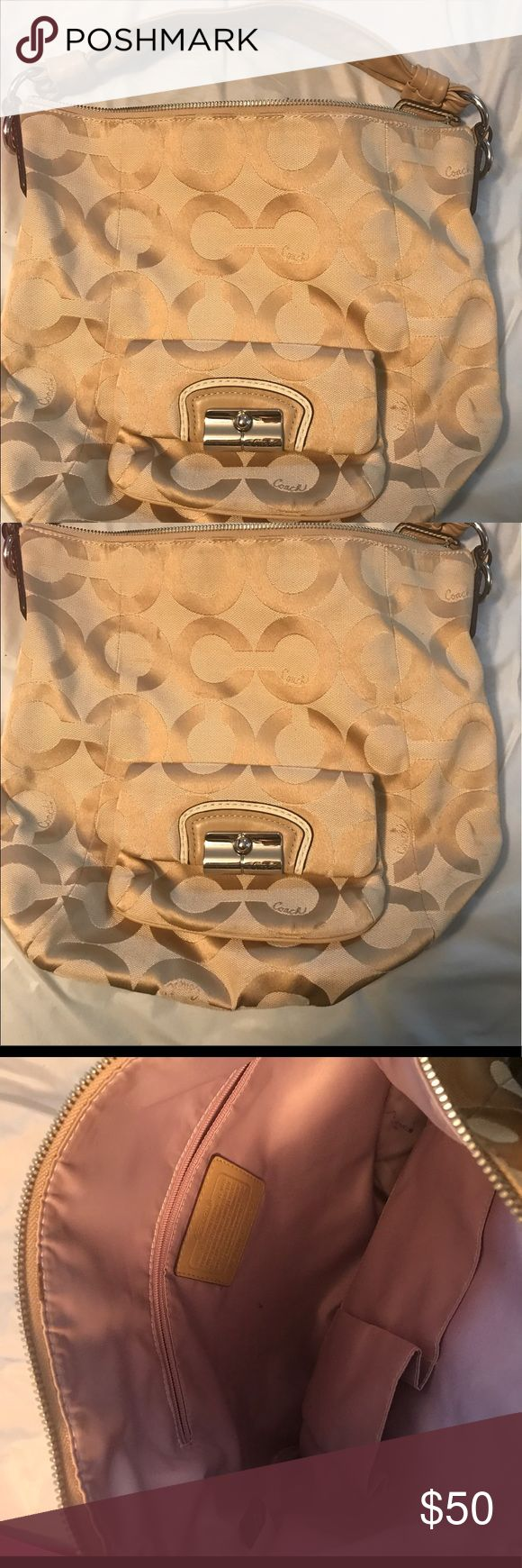 Coach shoulder bag Gently used.  Shoulder bag. Measures roughly 12X12.5. The only issue is that it has small pen marks (pictured).  The inner lining is purple! Coach Bags Shoulder Bags