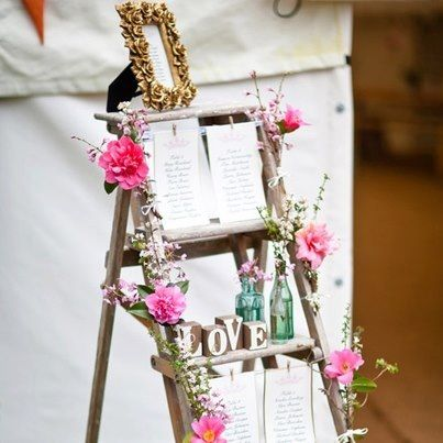 Incredible twist on a canvas stand. Would be beautiful for a wedding or a party!