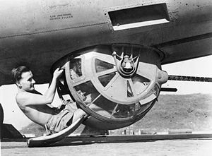A crewman poses with the Sperry ball turret of a Royal Air Force B-24, Burma, c.1943-1945