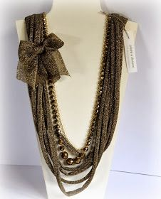 collana vestita a festa...in fettuccia lamè ,mezzi cristalli oro/bronzo e filo catena dorata