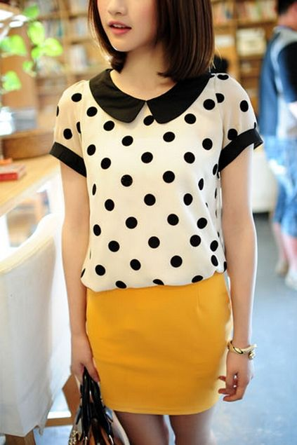 This blouse crafted in chiffon, featuring peter pan collar, dots printing to the main, short sleeves, in medium length cut.