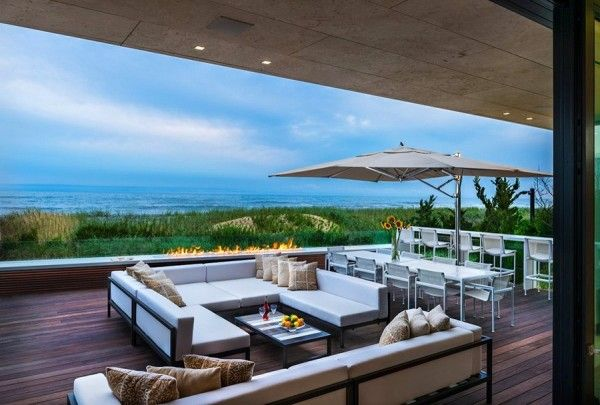 Open Space with Fireplace from Luxury Ocean House with Amazing Garden and Swimming Pool Ideas 600x405 Luxury Ocean House with Amazing Garden and Swimming Pool Ideas
