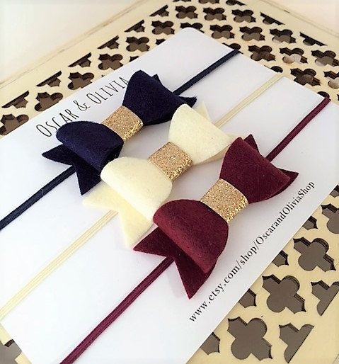 This set of three lovely felt bow headbands is the perfect hair accessory for the Winter season! The bows are hand crafted from high-quality wool blend felt and accented with a champagne glitter center. They are attached to skinny elastic in the size of your choice or make them