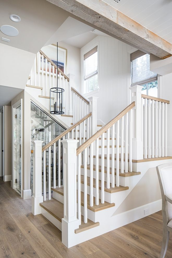The Staircase Features White Oak Threads White Oak Handrail And Vertical Tongue And Groove Paneling Beach House Interior House Stairs California Beach House