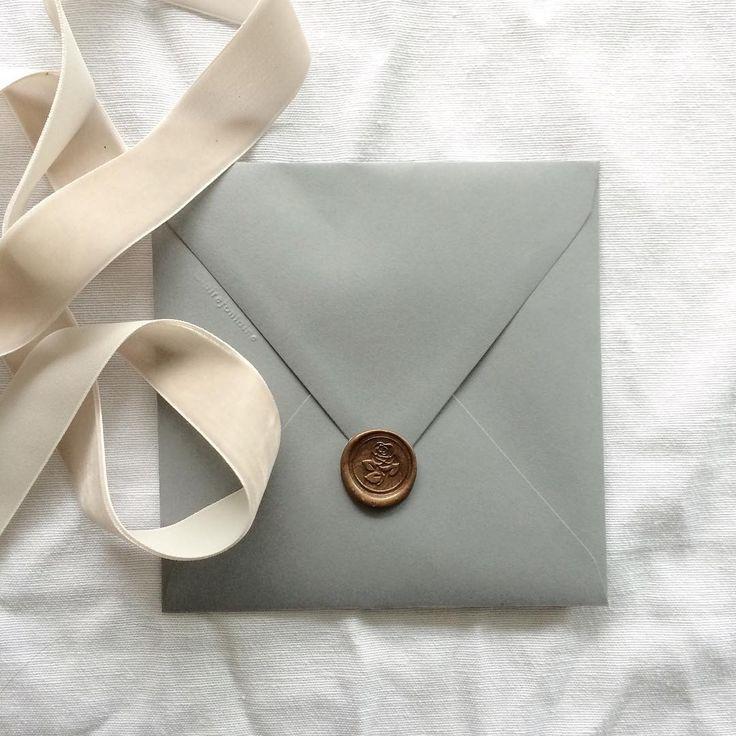grey envelope with bronze wax seal  • paulaleecalligraphy.com