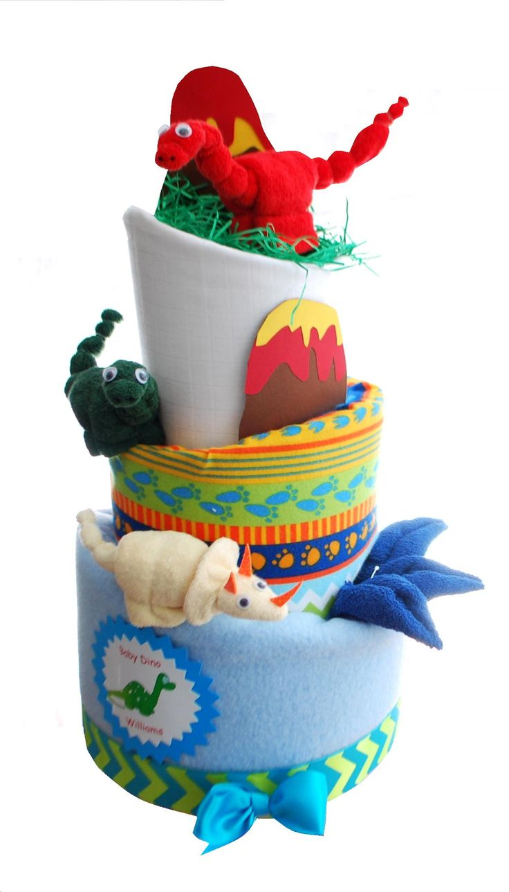 Nappy Cakes by owletgifts.co.uk. This is a dinosaur nappy cake, complete with dinosaur washcloth towel art dinosaurs. 3 tiers of   excellent practical baby items. Perfect baby shower gift or baby boy gift.
