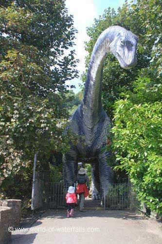 Dan-yr-Ogof Showcaves through the legs of this dinosaur accompanied with a recorded roar, near Abercrave / Brecon Beacons National Park, Powys County, Wales