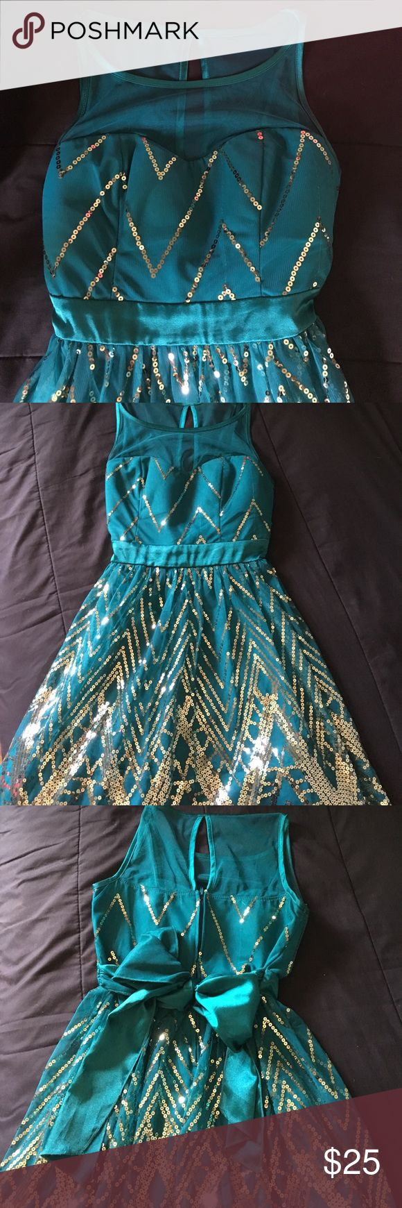 Formal dress Teal dress with gold sequences geometrically stitched.   This dress was worn a couple of times for cruise dinners and graduations. Ruby Rox Dresses Mini