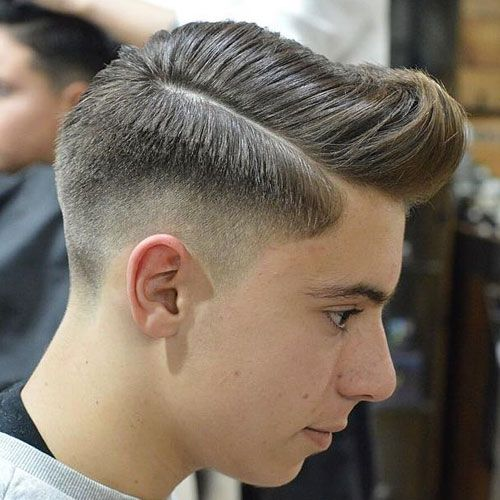 Medium Skin Fade with Hard Part Comb Over