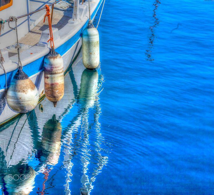 Marine Buoys - Fishing Boat Moored in the Marina in Greece.