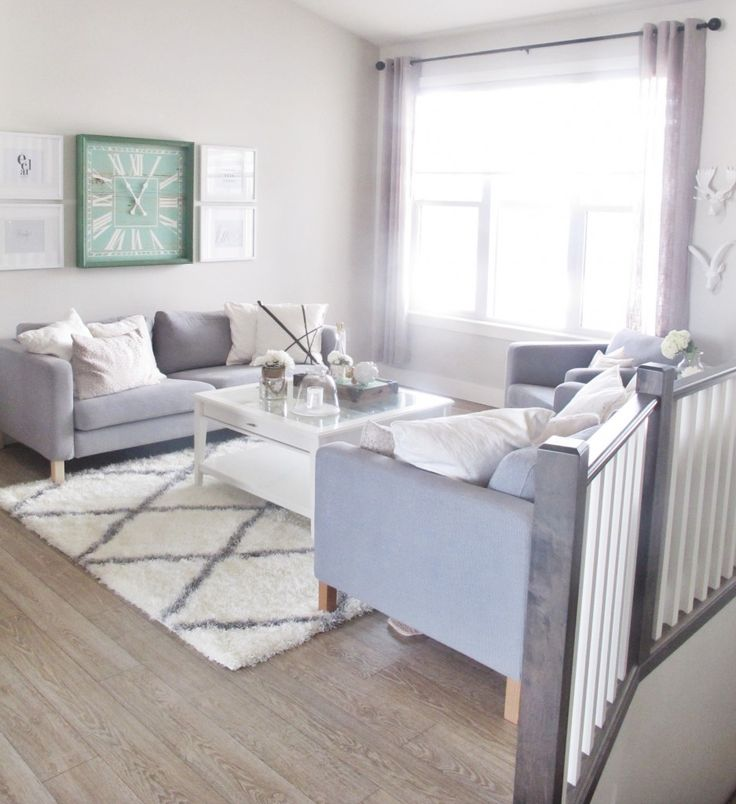 Look at this clean and crisp living room styled by white gold and sea foam green accents our for Grey and white rug living room