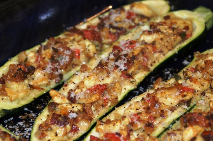 Zucchini stuffed with tomatoes, bacon and sauteed onions. The man of the house gave it his seal of approval.