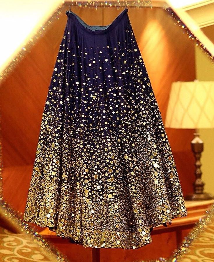 Geeta Basra's stunning midnight blue lehenga by Archana Kochhar with mirror work and Swarovski crystals. Photo Courtesy- @israniphotograph