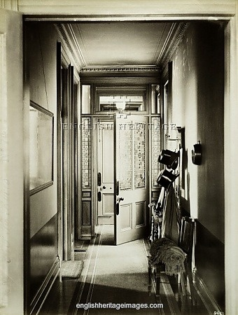 """GRAND AVENUE, Hove, East Sussex. Interior of the entrance hall looking towards the front door, with top hats on a rack. Photographed on the 24th August 1889. From the Bedford Lemere collection."""