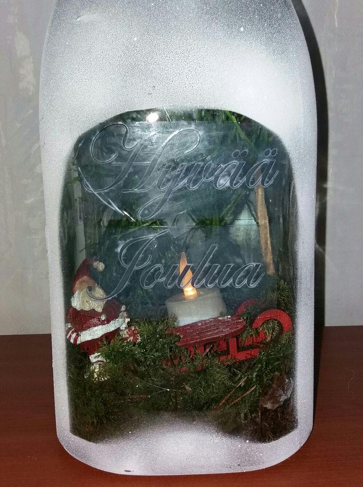 Pakkausteipillä teksti. Riihimäen 5l lasipurkki tuunattu jouluasuun