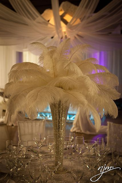Glitter & white feather decorations | White feather centerpieces | http://www.mybigdaycompany.com/corporate-events.html