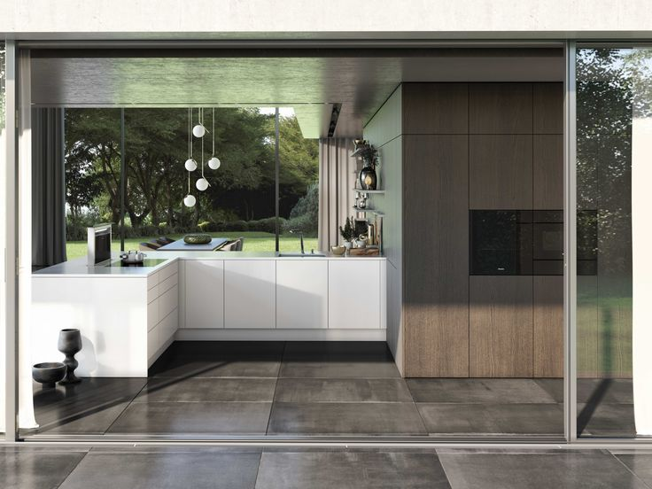 """SieMatic PURE / SE 8008 LM + SE 4004 H: Still a kitchen or a living space instead? – This example shows veneer wall panels and tall cabinets in """"graphite oak,"""" as well as base cabinets in """"lotus white"""" superior quality gloss lacquer. Veneer shelves become a harmonious part of the whole, and lacquered shelves pick up white tones to form a captivating contrast."""