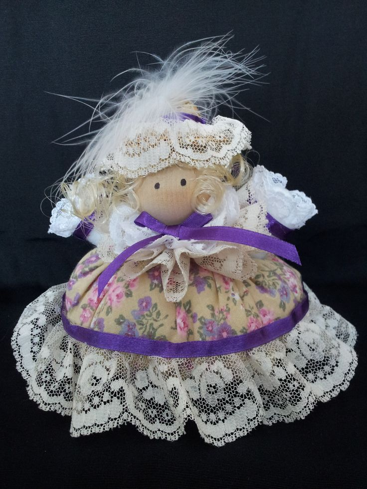 The Lady of Lavender Lane. Collectable Pin Cushion Doll. Material: Cotton & Lace. $25.00CAD + S/H if applicable. $0.00 Tax. Please contact Nola at: https://www.facebook.com/elegantcreationsbynola for purchase